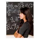 Teenage girl student at blackboard with math postcard