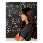 Teenage girl student at blackboard with math poster