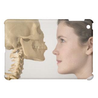 Teenage girl with skeleton iPad mini cases