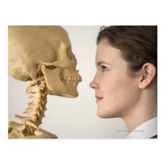 Teenage girl with skeleton postcard