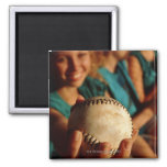 Teenage girls' softball team sitting in dugout 2 inch square magnet