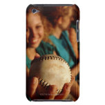 Teenage girls' softball team sitting in dugout iPod touch cases