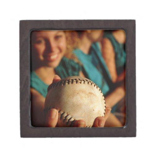 Teenage girls' softball team sitting in dugout premium jewelry boxes