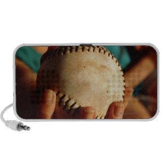 Teenage girls' softball team sitting in dugout iPod speakers