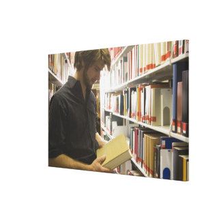 Teenage student in library canvas print