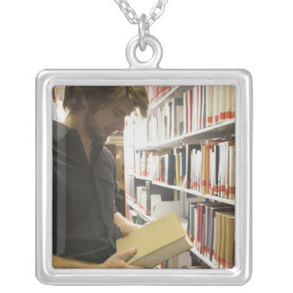 Teenage student in library jewelry