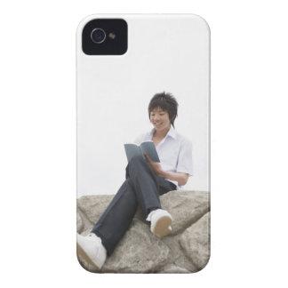 Teenageboy sitting on dock iPhone 4 Case-Mate cases