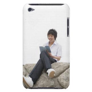 Teenageboy sitting on dock iPod Case-Mate case