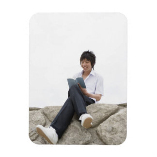 Teenageboy sitting on dock magnet