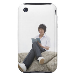 Teenageboy sitting on dock tough iPhone 3 cases