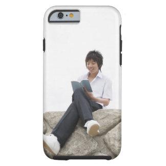Teenageboy sitting on dock tough iPhone 6 case