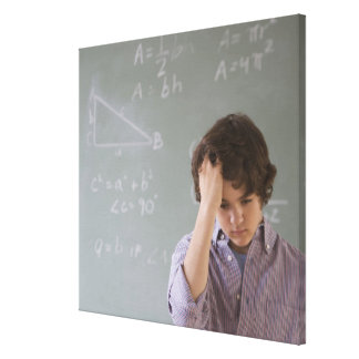 Teenaged boy in front of blackboard with math canvas print