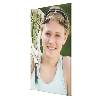 Teenaged girl holding lacrosse racket canvas print
