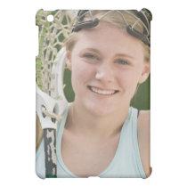 Teenaged girl holding lacrosse racket iPad mini cover