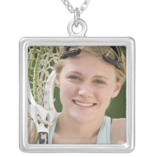 Teenaged girl holding lacrosse racket silver plated necklace
