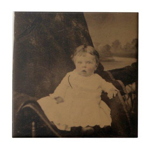 Teja antigua de la foto del bebé