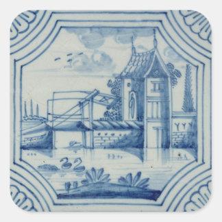 Teja de Delft que muestra un puente levadizo sobre Colcomanias Cuadradases