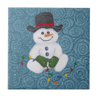 Teja del muñeco de nieve que se sienta
