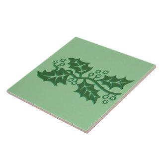 Teja - hojas del acebo con las bayas