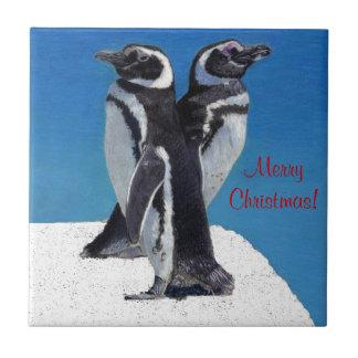 Teja linda del navidad del pingüino