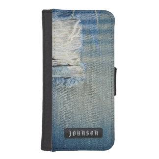 Tejanos rasgados del dril de algodón con los hilos billetera para teléfono