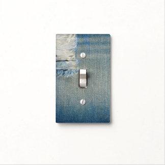 Tejanos rasgados del dril de algodón con los hilos placa para interruptor