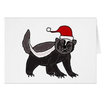 Tejón de miel divertido en el gorra de Santa Felicitacion