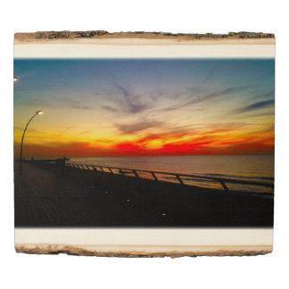 Tel Aviv port's colourful sky at sunset Wood Panel