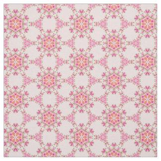 Tela con los copos de nieve rosados, verdes, telas