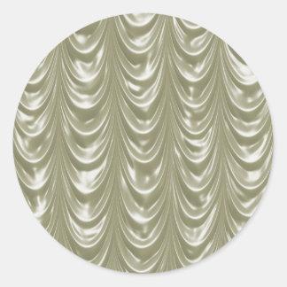 Tela de satén color nata con el modelo horneado a pegatina redonda