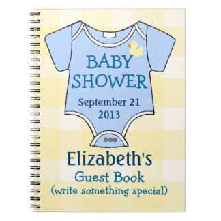Tela escocesa amarilla y libro de visitas azul de cuadernos