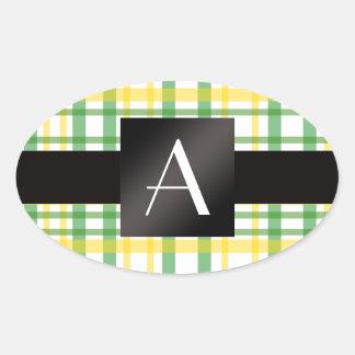 Tela escocesa amarilla y verde del monograma pegatina de oval