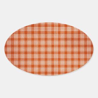 Tela escocesa anaranjada pegatina ovalada