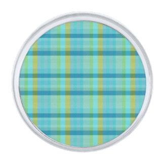 Tela escocesa azul insignia plateada