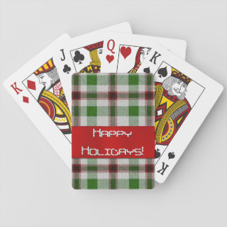Tela escocesa del navidad con la cinta roja baraja de póquer