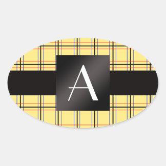 Tela escocesa negra amarilla del monograma pegatina de ovaladas