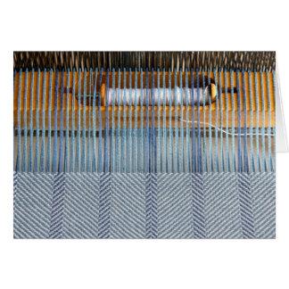 Telar de la tabla con tejer de la tela cruzada tarjeta de felicitación