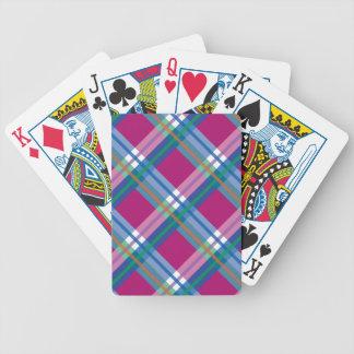 Telas escocesas, controles y tartanes en rosas y a barajas de cartas
