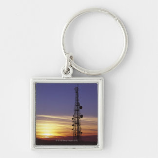 Telecommunications mast at sunset keychain