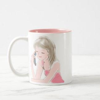 teléfono del portable del chica taza