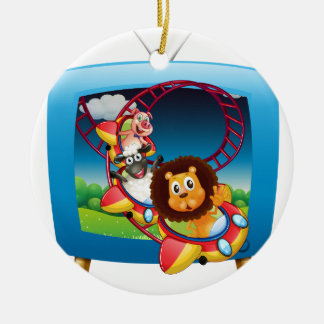 Television screen with animals on the rollercoaste ceramic ornament