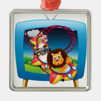 Television screen with animals on the rollercoaste metal ornament