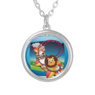 Television screen with animals on the rollercoaste round pendant necklace