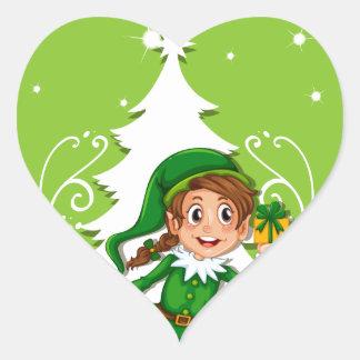 Tema de las felices Navidad con el duende y el Pegatina En Forma De Corazón