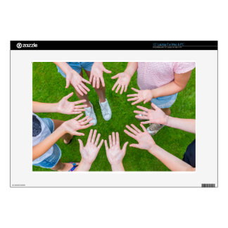 "Ten arms of children in circle with palms of hands 15"" laptop skins"