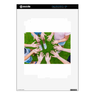 Ten arms of children in circle with palms of hands decal for iPad 2