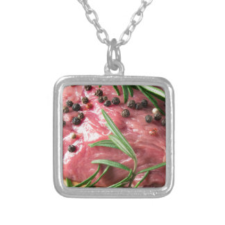 Tenderloin of raw beef silver plated necklace