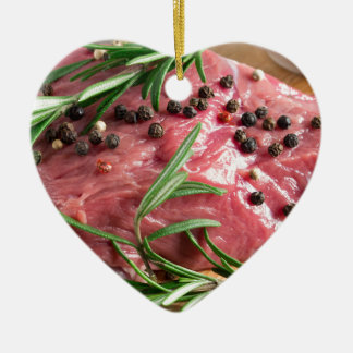 Tenderloin of raw beef with herbs and spices ceramic ornament