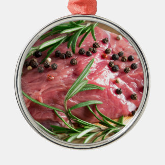 Tenderloin of raw beef with herbs and spices metal ornament