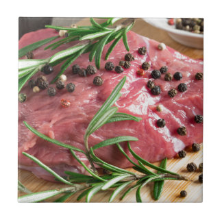 Tenderloin of raw beef with herbs and spices tile